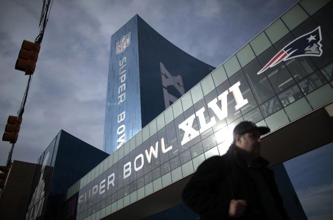 A man walks in downtown Indianapolis ahead of the Super Bowl XLVI NFL football game