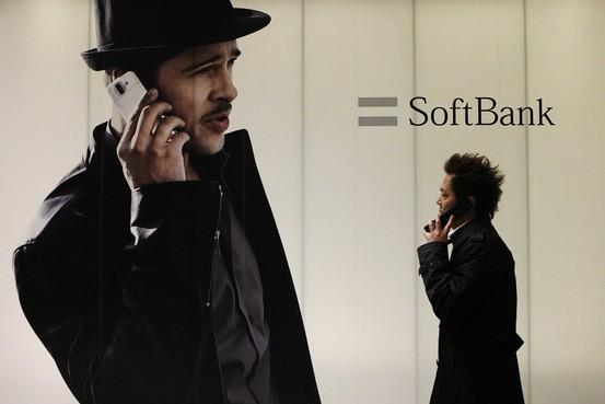File picture shows people walking in front of a logo of Softbank Corp at its branch in Tokyo