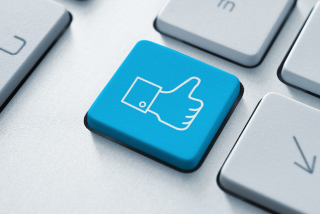 Thumb up like button on the keyboard. Toned Image.