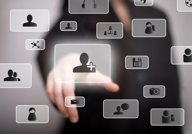 hand pressing social media buttons