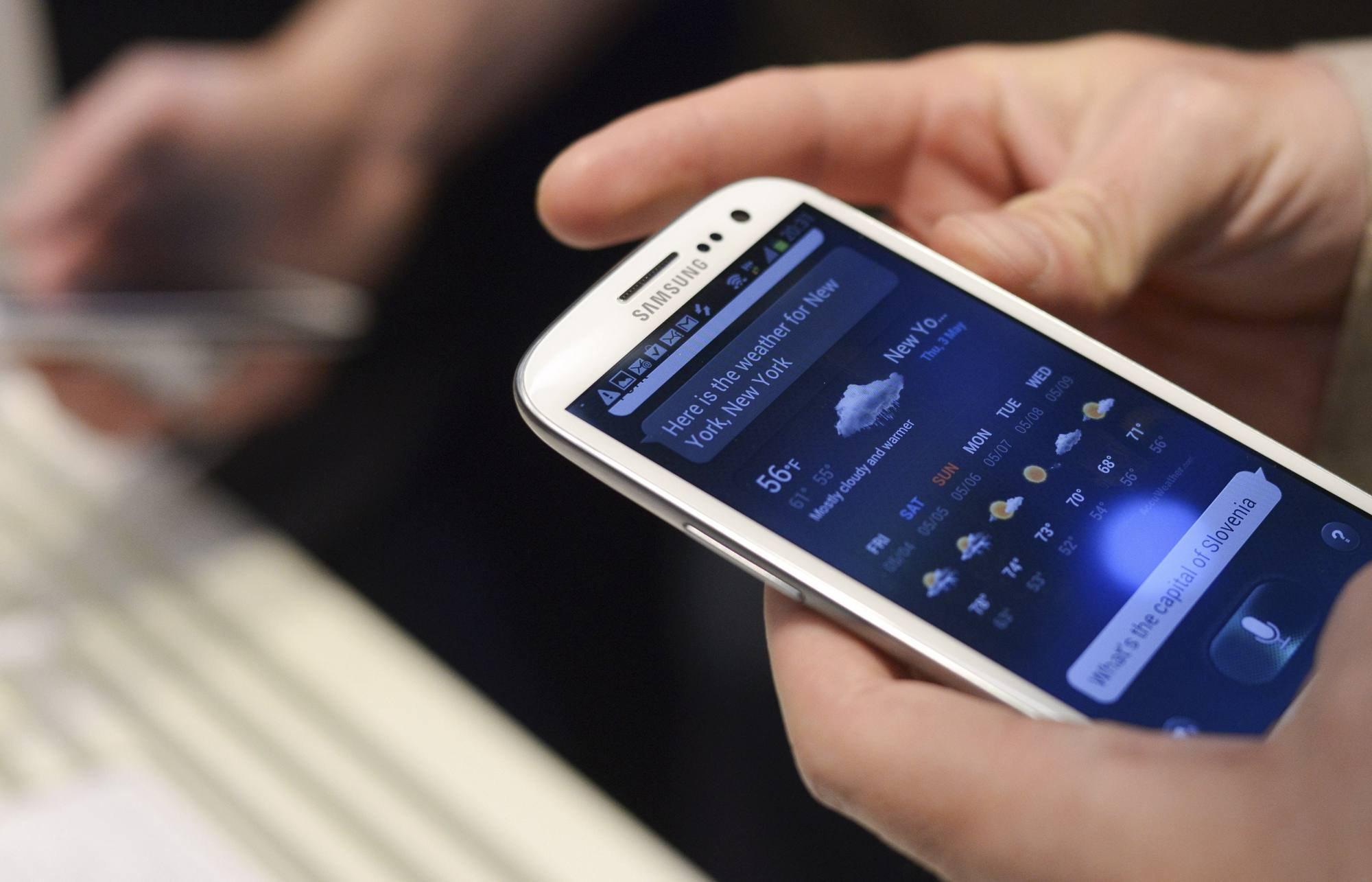 A man uses Samsung Electronics' new Samsung Galaxy SIII smartphone during its launch in London