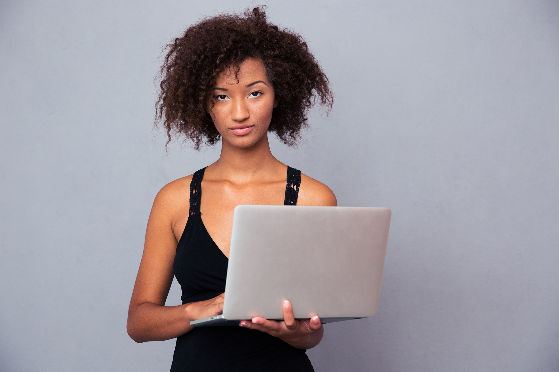 Afro american woman using laptop