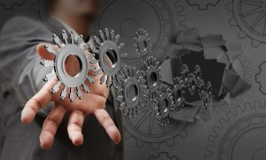 businessman-hand-shows-people-cogs_GyA6cFSO-min
