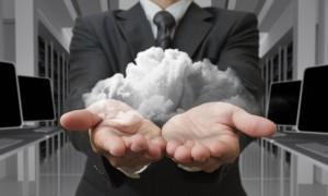 businessman-holding-cloud-in-hands_fyiRFKH_-min